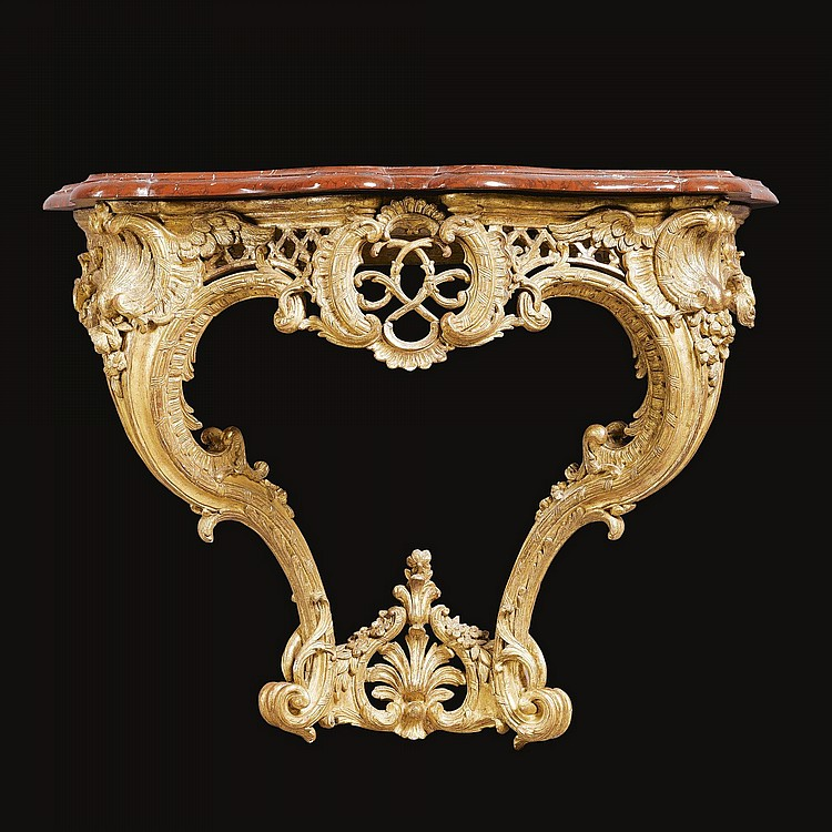 A CARVED GILTWOOD CONSOLE TABLE IN THE MANNER OF NICOLAS PINEAU (1684 -1754) EARLY LOUIS XV, CIRCA 1735
