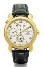 VACHERON CONSTANTIN | A YELLOW GOLDDUAL-TIME AUTOMATIC WRISTWATCH WITHDATE AND REGULATOR DIAL <br />REF 42005 CASE 744294 CIRCA 2001