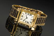 CARTIER | A RARE YELLOW GOLD AND ENAMEL RECTANGULAR WRISTWATCH WITH CONCEALED DIAL<br />CASE 22466 TANK OBUS SAVONETTE CIRCA 1930