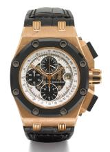 AUDEMARS PIGUET | A LIMITED EDITION PINK GOLD AND CERAMIC AUTOMATIC CHRONOGRAPH WRISTWATCH WITH REGISTERS AND DATE <br />NO 130/500 ROYAL OAK OFFSHORE RUBENS BARRICHELLO CIRCA 2012