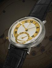GEORGE DANIELS | A RARE WHITE GOLD AUTOMATIC CENTRE SECONDS WRISTWATCH WITH TWO-TONE GOLD DIAL, DATE AND DANIELS SLIM CO-AXIAL ESCAPEMENT<br />MILLENNIUM 1999