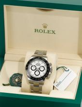 ROLEX | A STAINLESS STEEL AND CERAMIC AUTOMATIC CHRONOGRAPH WRISTWATCH WITH REGISTERS AND BRACELET <br />REF 116500LN CASE 916Q95D8 DAYTONA CIRCA 2016