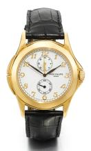PATEK PHILIPPE | A YELLOW GOLD DUAL TIME WRISTWATCH WITH 24-HOUR INDICATION<br />REF 5134 MVT 3085134 CASE 4183014 CALATRAVA TRAVEL TIME MADE IN 2002