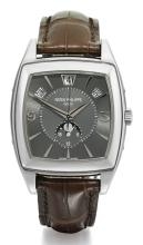 PATEK PHILIPPE | A WHITE GOLD TONNEAU-FORM AUTOMATIC ANNUAL CALENDAR CENTER SECONDS WRISTWATCH WITH MOON PHASES <br />REF 5135 MVT 3920560 CASE 4474689 MADE IN2008