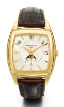 PATEK PHILIPPE | AYELLOW GOLD TONNEAU-FORM AUTOMATIC ANNUAL CALENDAR CENTRE SECONDS WRISTWATCH WITH MOON PHASES<br />REF 5135 MVT 3423597 CASE MADE IN 2005