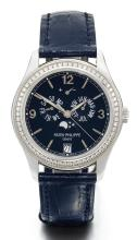 PATEK PHILIPPE | AWHITE GOLD AND DIAMOND-SET AUTOMATIC CENTRE SECONDS ANNUAL CALENDAR WRISTWATCH WITH POWER RESERVE INDICATION AND MOON-PHASES <br />REF 5147G MVT3802471 CASE4712246 MADE IN 2009
