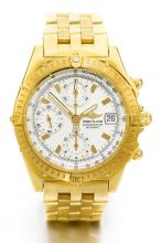BREITLING | A YELLOW GOLD AUTOMATIC CHRONOGRAPH WRISTWATCH WITH REGISTERS DATE AND BRACELET <br />REF K13352 CASE 330467 CIRCA 2000