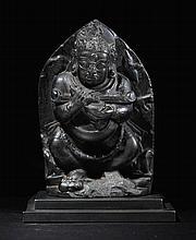 A BLACK STONE FIGURE OF PANJARNATA MAHAKALA TIBETO-CHINESE, 14TH CENTURY |
