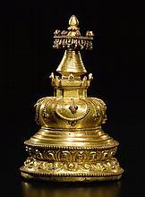 A GILT-BRONZE STUPA TIBET, 15TH CENTURY |