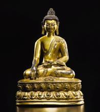 A GILT-BRONZE FIGURE DEPICTING BUDDHA TIBET, 14TH CENTURY |