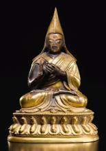 A GILT-BRONZE FIGURE OF TSONG KHAPA TIBETO-CHINESE, 18TH CENTURY |
