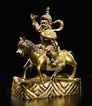 A GILT-BRONZE FIGURE OF SHANGPA KARPO TIBETO-CHINESE, 18TH/19TH CENTURY |