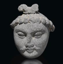 A GREY SCHIST HEAD OF A BODHISATTVA ANCIENT REGION OF GANDHARA, KUSHAN PERIOD, 3RD CENTURY |