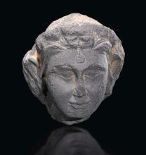 A GREY SCHIST HEAD OF A FEMALE ANCIENT REGION OF GANDHARA, KUSHAN PERIOD, 3RD CENTURY |