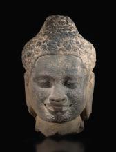 A GREY SANDSTONE HEAD OF BUDDHA KHMER, LATE 12TH/EARLY 13TH CENTURY |
