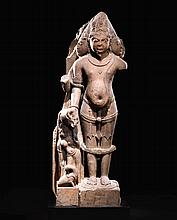 A SANDSTONE FIGURE OF BRAHMA INDIA, RAJASTHAN OR GUJARAT,9TH/10TH CENTURY  