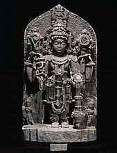 A LARGE STONE STELE DEPICTING VISHNU INDIA, KARNATAKA, HOYSALA PERIOD, 12TH/13TH CENTURY  
