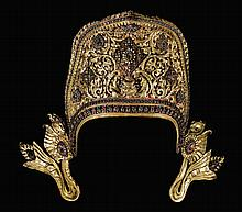 A GILT-COPPER REPOUSSÉ CROWN OF INDRA INLAID WITH PASTE AND SEMI-PRECIOUS STONES NEPAL, 17TH CENTURY |