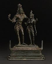 A BRONZE GROUP OF SHIVA EMBRACING UMA (ALINGANAMURTI) SOUTHERN INDIA, CHOLA PERIOD, 12TH CENTURY |