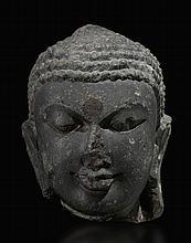 A CHLORITE HEAD OF BUDDHA WESTERN INDIA, CHALNKYA PERIOD, 7TH-9TH CENTURY |