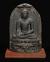 A BLACK STONE FIGURE OF BUDDHA CALLING THE EARTH TO WITNESS EASTERN INDIA, PALA PERIOD, 9TH/10TH CENTURY |