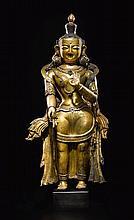A GILT-COPPER REPOUSSÉ FIGURE OF TARA NEPAL, 16TH / 17TH CENTURY |