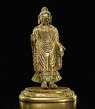 A GILT-BRONZE FIGURE OF BUDDHA SHAKYAMUNI TIBETO-CHINESE, QING PERIOD, 18TH CENTURY |
