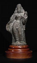 A GRANITE FIGURE OF SHRIDEVI OR BHUDEVI SOUTH INDIA, VIJAYANAGAR PERIOD, CIRCA 15TH CENTURY |