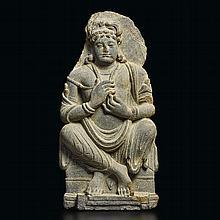 A GREY SCHIST FIGURE OF A SEATED BODHISATTVA ANCIENT REGION OF GANDHARA, KUSHAN PERIOD, 2ND/3RD CENTURY  