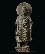 A GREY SCHIST FIGURE OF A STANDING BUDDHA ANCIENT REGION OF GANDHARA, KUSHAN PERIOD, 2ND/3RD CENTURY  