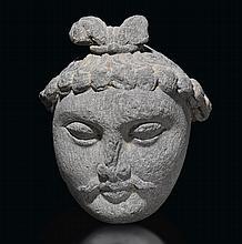 A GREY SCHIST HEAD OF A BODHISATTVA ANCIENT REGION OF GANDHARA, KUSHAN PERIOD, 3RD CENTURY  