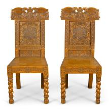 A PAIR OF SCOTTISH WILLIAM IV 'ANTIQUARIAN' CARVED OAK HALL CHAIRS BY G. TROUP, DATED 1835 |