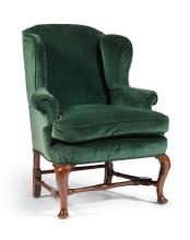A GEORGE II GREEN VELVET UPHOLSTERED, CARVED WALNUT AND STAINED BEECH WING BACK ARMCHAIR, SECOND QUARTER 18TH CENTURY |