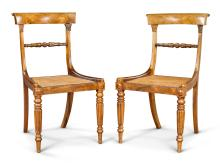A PAIR OF LATE REGENCY CARVED ROSEWOOD AND CANE CHAIRS ATTRIBUTED TO WILLIAM TROTTER OF EDINBURGH, CIRCA 1818 |