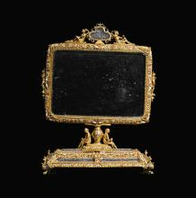 AN UNUSUAL ROCK CRYSTAL, SILVER-GILT AND ENAMEL DOUBLE-SIDED TOILET MIRROR, PROBABLY HERMANN RATZERSDORFER, AUSTRO-HUNGARIAN, CIRCA 1900 | An unusual rock crystal, silver-gilt and enamel double-sided toilet mirror, probably Hermann Ratzersdorfer,