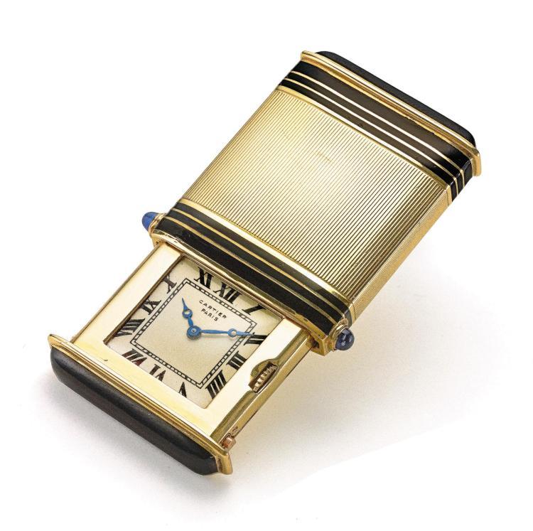 CARTIER | A YELLOW GOLD AND ENAMEL TRAVEL WATCH CASE 3510 CIRCA 1925