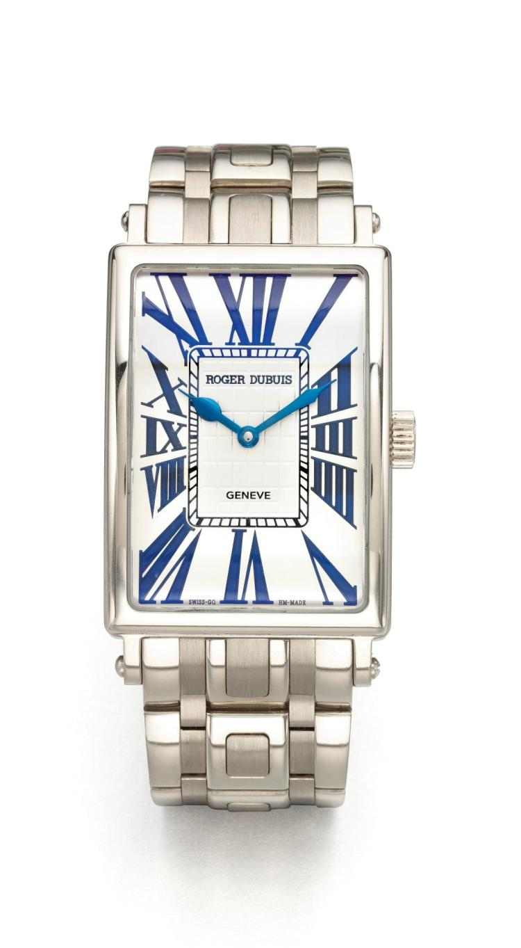 ROGER DUBUIS | AN OVERSIZED WHITE GOLD RECTANGULAR AUTOMATIC WRISTWATCH WITH BRACELET MVT 10745 NO 12/28 MUCH MORE CIRCA 2002
