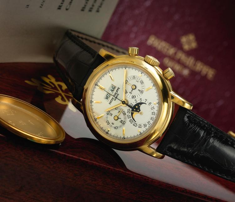 PATEK PHILIPPE | A FINE YELLOW GOLD PERPETUAL CALENDAR CHRONOGRAPH WRISTWATCH WITH MOON PHASES LEAP YEAR AND 24 HOUR INDICATION REF 3970J MVT 3045736 CASE 2994018 MADE IN 1998