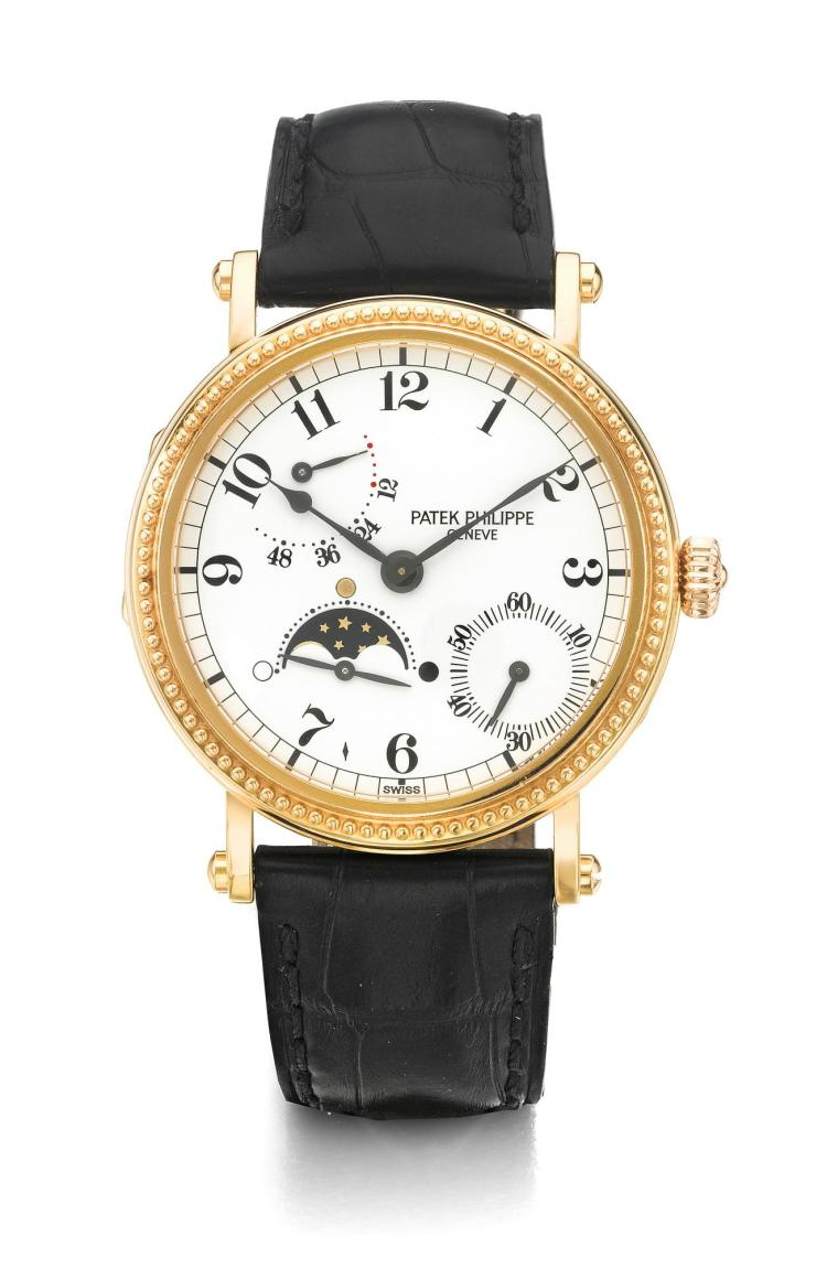 PATEK PHILIPPE | A PINK GOLD AUTOMATIC WRISTWATCH WITH MOON PHASES AN POWER RESERVE INDICATION REF 5015R MVT 3051711 CASE 4010620 MADE IN1996