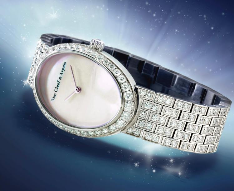 VAN CLEEF & ARPELS | A LADY'S WHITE GOLD AND DIAMOND SET OVAL BRACELET WATCH WITH MOTHER OF PEARL DIAL REF HH22275 CASE 3412126 TIMELESS CIRCA 2012