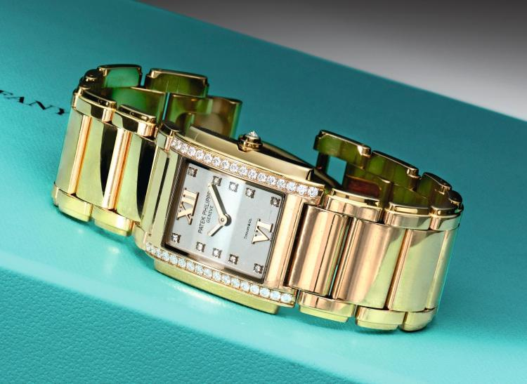 PATEK PHILIPPE   RETAILED BY TIFFANY & CO.: A LADY'S PINK GOLD AND DIAMOND SET RECTANGULAR WRISTWATCH WITH BRACELET REF 4910R MVT5723412 CASE4602470 TWENTY-4 MADE IN 2013