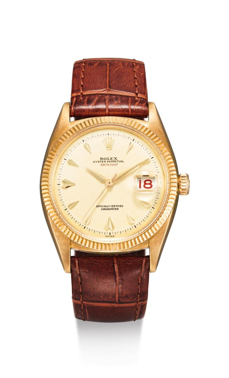 ROLEX | A YELLOW GOLD AUTOMATIC CENTER SECONDS WRISTWATCH WITH DATE REF 6305 CASE 97602 CIRCA 1955