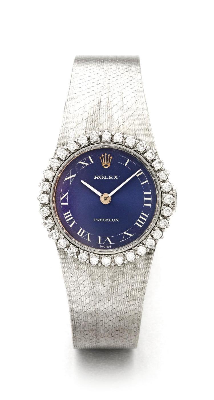 ROLEX   A LADY'S WHITE GOLD DIAMOND SET BRACELET WATCH REF 250 CIRCA 1975