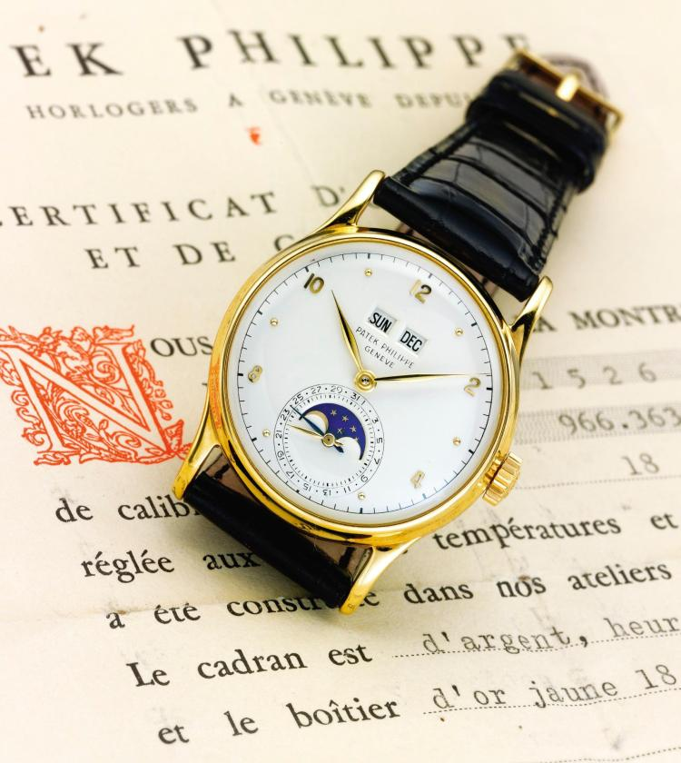 PATEK PHILIPPE | A FINE YELLOW GOLD PERPETUAL CALENDAR WRISTWATCH WITH MOON PHASES REF 1526 MVT 966363 CASE 663005 MADE IN1950