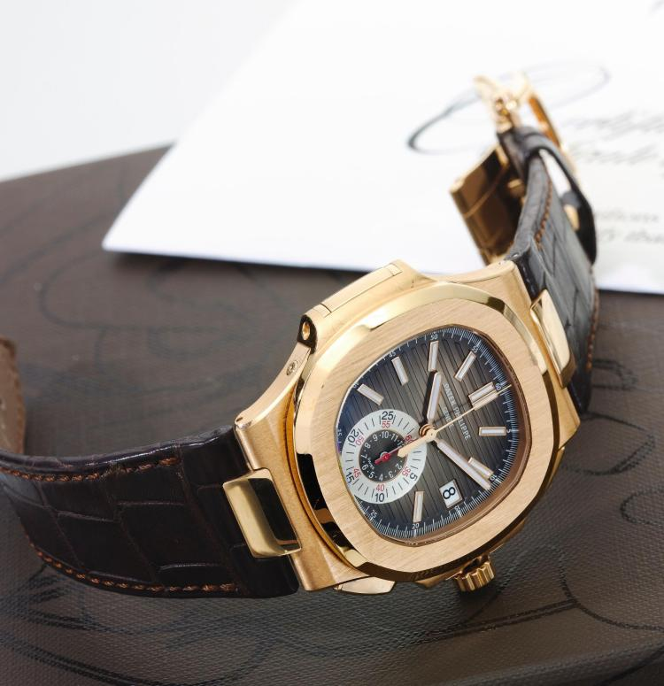 PATEK PHILIPPE | A PINK GOLD AUTOMATIC CHRONOGRAPH WRISTWATCH WITH DATE AND REGISTER REF 5980 MVT 5940369 NAUTILUS CIRCA 2012