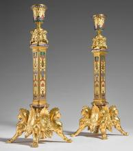 FERDINAND BARBEDIENNE<BR>FRENCH, 1810-1892<BR>A PAIR OF FINE GILT BRONZE AND CLOISONNÉ ENAMEL CANDLESTICKS<BR>PARIS, DATED 1872 |
