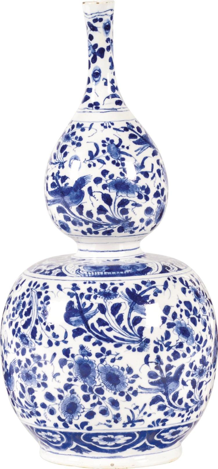 A DUTCHDELFT BLUE AND WHITE DOUBLE GOURD VASE, 1685-1700 |