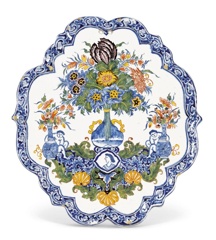 A DUTCH DELFT POLYCHROME CARTOUCHE-SHAPED PLAQUE, DATED 1737 OR 1757 |