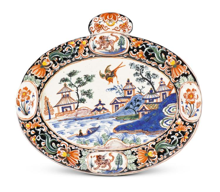 A DUTCH 'BLACK DELFT' SMALL OVAL PLAQUE, EARLY 18TH CENTURY |