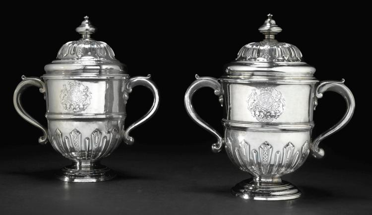 ROYAL. A PAIR OF GEORGE I SILVER TWO-HANDLED CUPS AND COVERS, NICHOLAS CLAUSEN AND ABRAHAM BUTEUX, LONDON, 1719 |